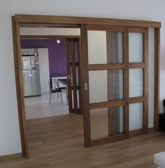 Porte scorrevoli esterne in legno massello e vetro - Falegnameria ...